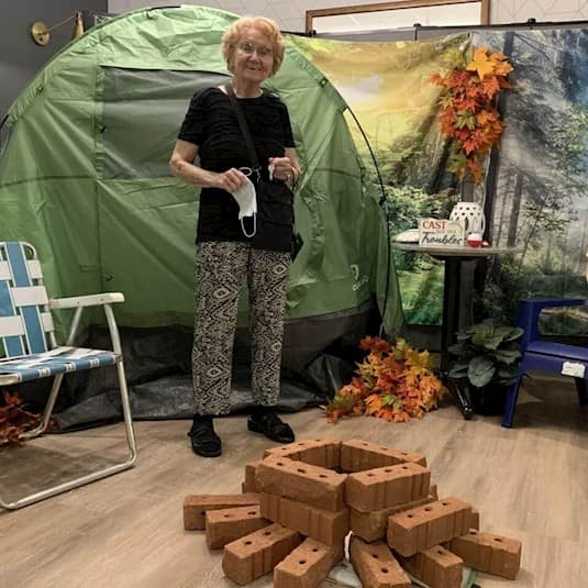 Getting into the spirit of Revera's Escape to the Outdoors - Cottage Living summer themed recreation programming is Alice Bowick, a resident at Revera's The Kensington Oakville
