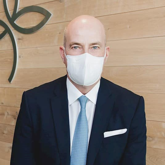 Tom Wellner, CEO of Revera, wearing a mask