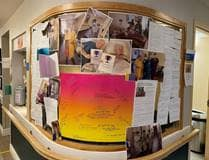 Notice board with photos and messages