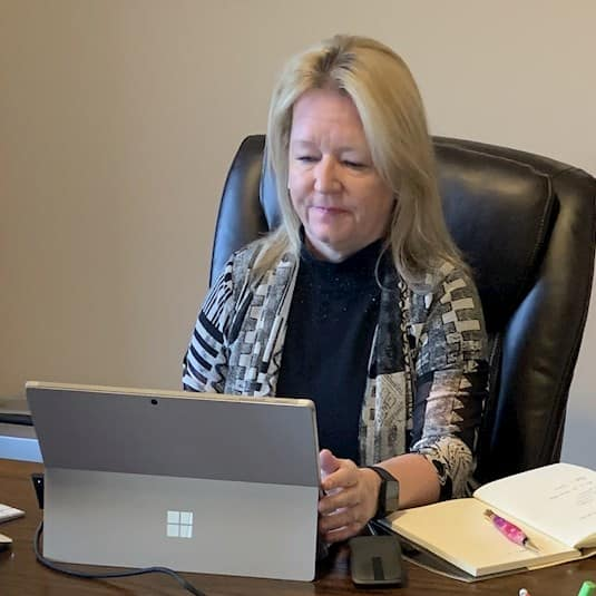 Dr. Rhonda Collins, CMO of Revera, working at her home office