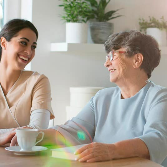 Employee sharing a few moments with a senior