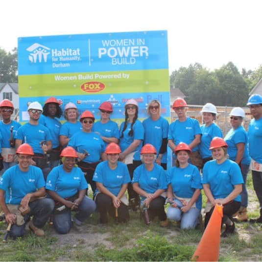 Group photo of volunteers at a Habitat build event