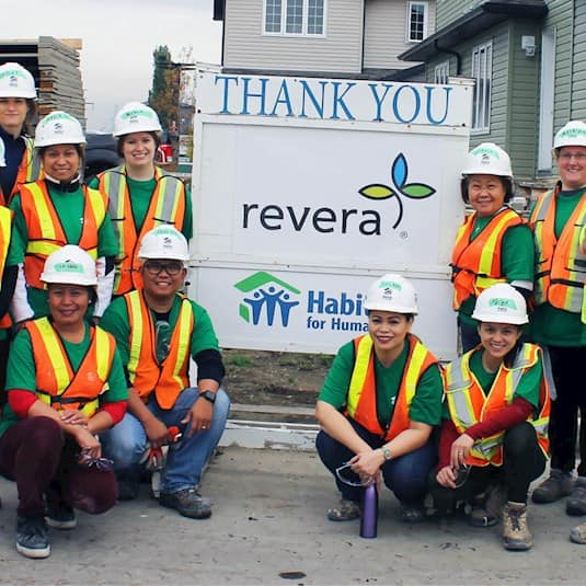 A group of Revera employees pose at a build event for Habitat for Humanity