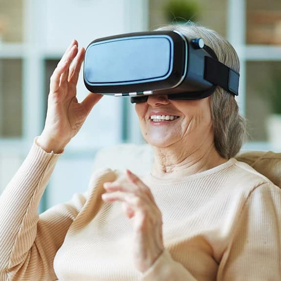 A woman smiles while using a virtual reality device