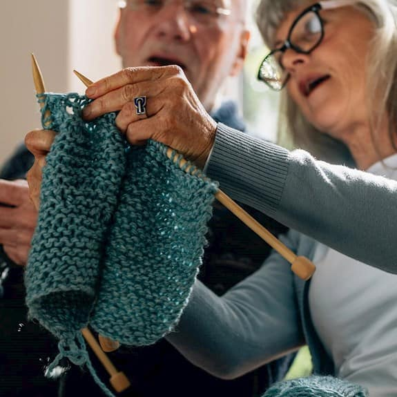 Two of Revera's Knotty Knitters working on a project