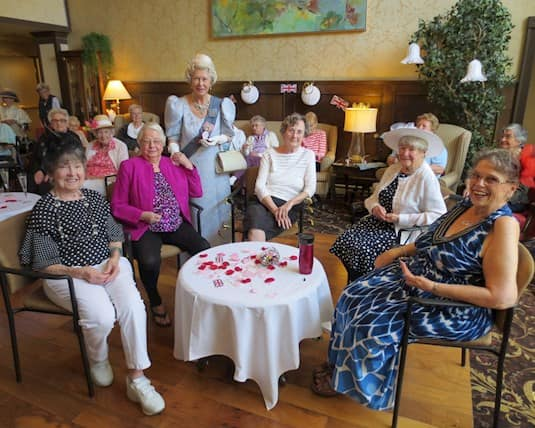 Residents at The Kensington Victoria enjoy an afternoon with the Queen before the COVID-19 pandemic.