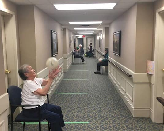 Residents participate in a hallway workout program at McKenzie Towne Retirement Residence in Calgary