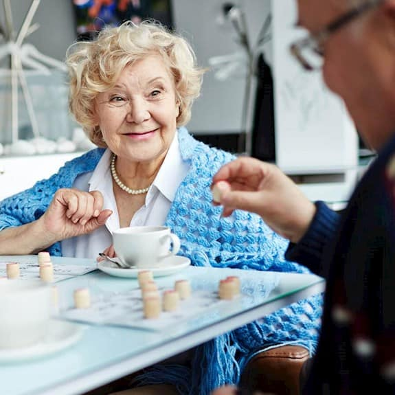 A group of older adults sitting together playing a game