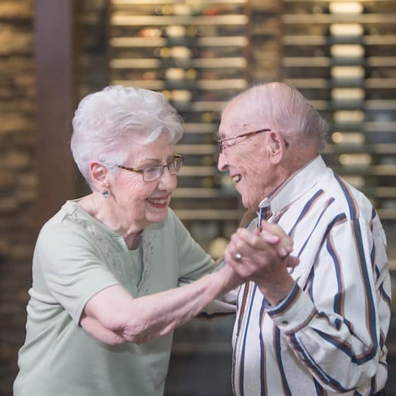 Two Revera residents dancing