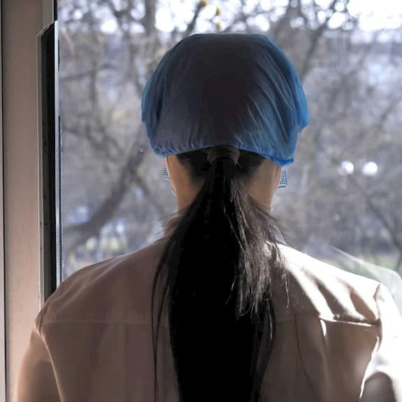 Staff member looking out of window