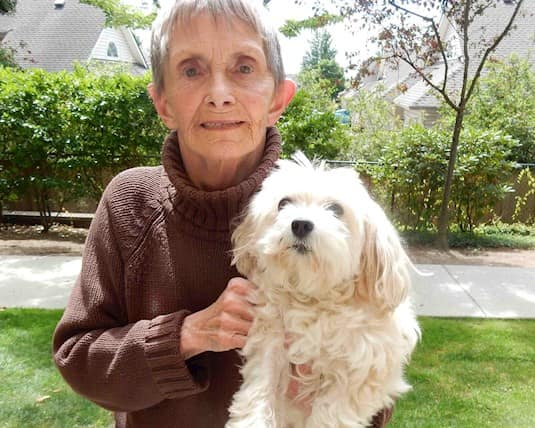 Lynn Chamberlin and Bailey enjoy being outside at Fleetwood Villa retirement community in Surrey, British Columbia