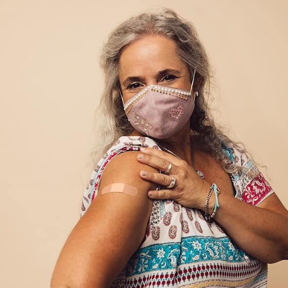 Woman showing her arm after taking vaccine