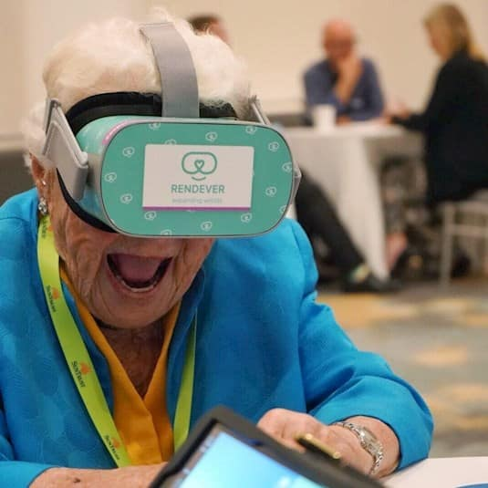 Hazel McCallion having fun with Rendever's VR technology