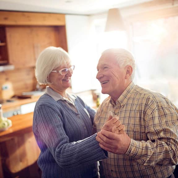 Older couple danicing in the kitchen