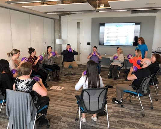 Revera's Recreation teams take part in a training session on the Tiered Exercise Program to bring back to their residences to prevent falls and injuries.