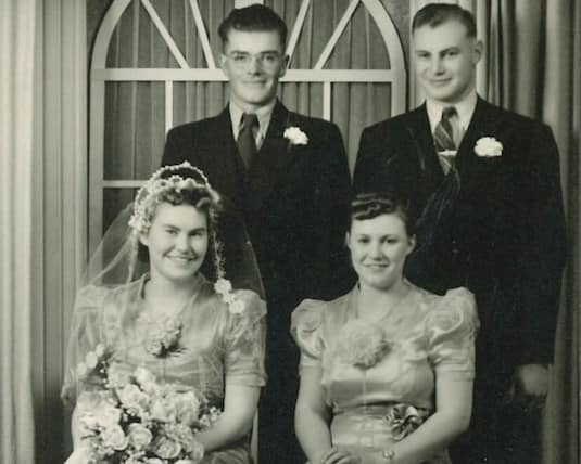 Mildred and Russell Wright pose for a picture with their best-man and maid-of-honour on their wedding day on October 19th, 1940.