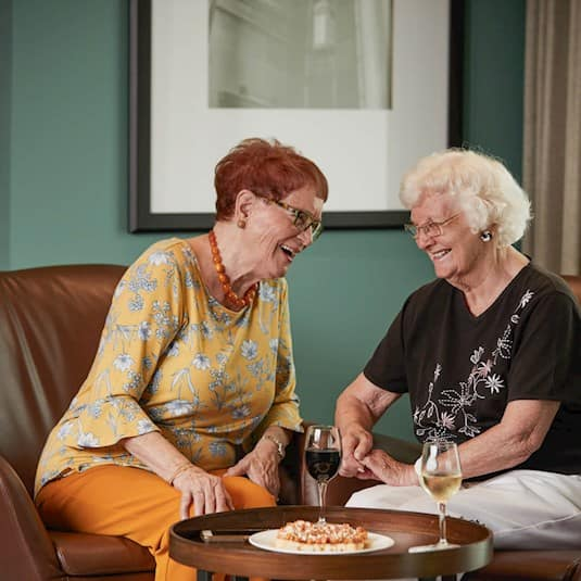 two women enjoying a glass of wine