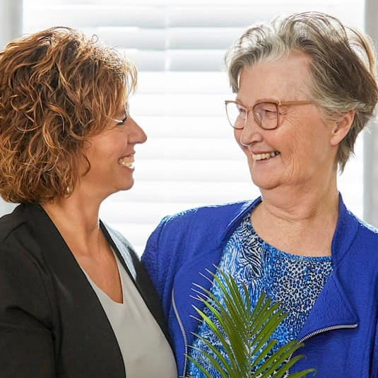 Two women smiling at each other