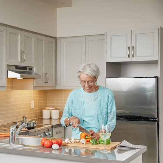 woman doing dishes in the kitchen