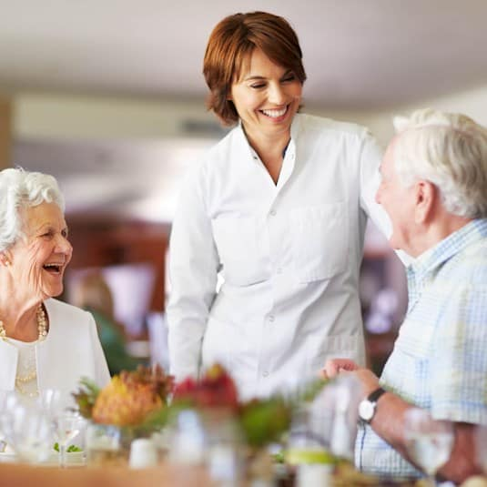 chef talking to seniors in restaurant