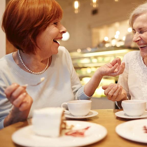 two women enjoying coffee and pastries