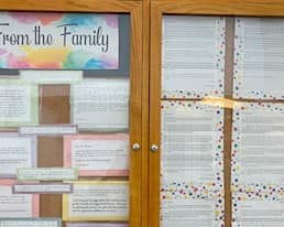 A bulletin board at a residence showing letters and tesimonials from family members of residents