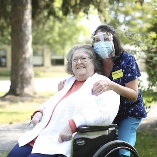 Margaret, a PSW, with a long term care resident