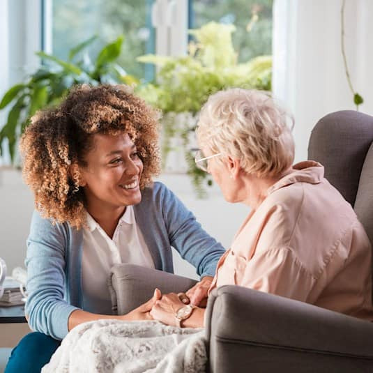 caregiver and resident talking