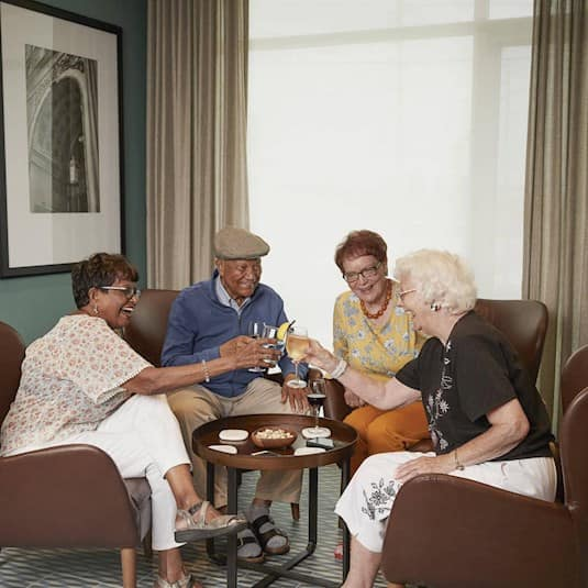 A group of seniors making a toast