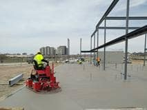 Working on finishing the north wing slab on grade