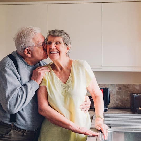 Couple in the kitchen sharing a special moment
