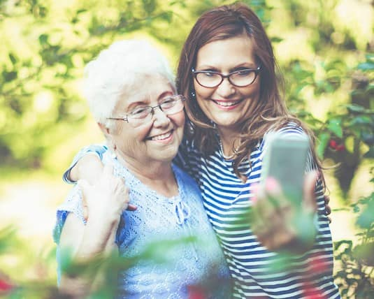 Two women, one older, and one younger, taking a selfie